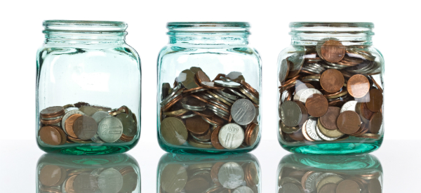 Glass Jars with Coins (Shutterstock.com)