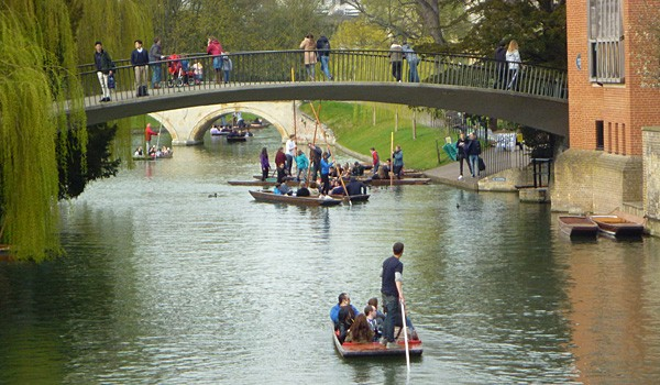 Punting along the Backs, a Popular Pastime with Students (Godfrey Hall)