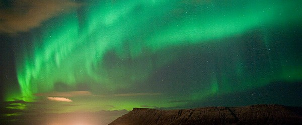 Northern Lights north of Reykjavik Featured (Shutterstock.com)