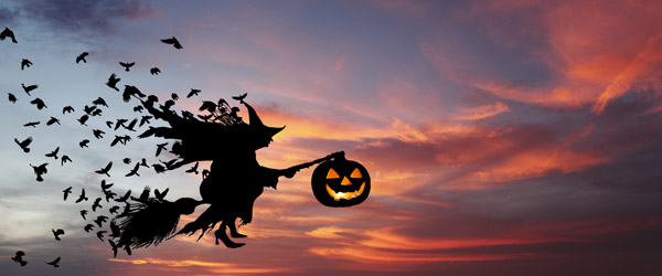 Flying Witch on a Broomstick with a Pumpkin Lantern (Shutterstock.com)