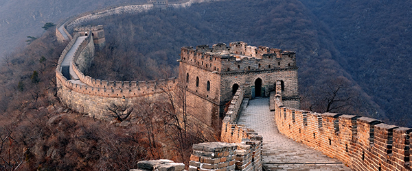 Great Wall Over Sunset in Mountains Featured (Shutterstock.com)