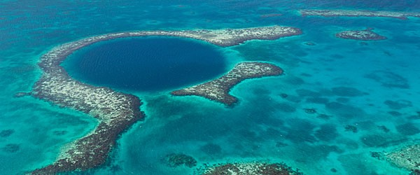 The Blue Hole, Famous Diving Spot Off the Coast Of Belize Featured (Shutterstock.com)