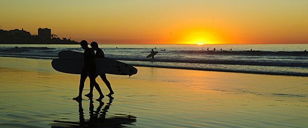 Surfers at La Jolla Shore, San Diego Featured (Shutterstock.com)