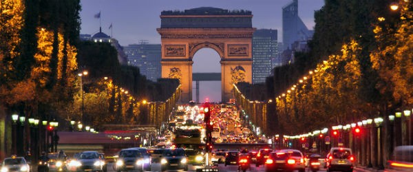 Paris, Champs-Elysees at Night Featured (Shutterstock.com)