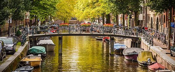 Bridge over Canal, Amsterdam Featured (Shutterstock.com)